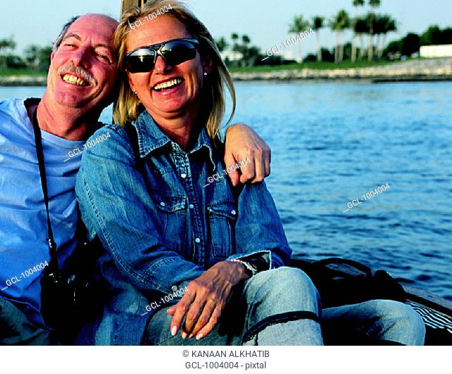 Western couple on sightseeing tour on the creek in Dubai, United Arab Emirates