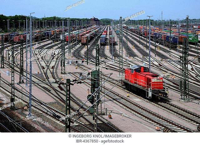 Red locomotive, in the back containers on the tracks, railroad yard Maschen, Seevetal, Lower Saxony, Germany