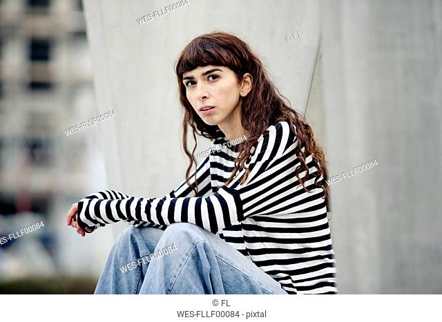 young woman wearing striped shirt