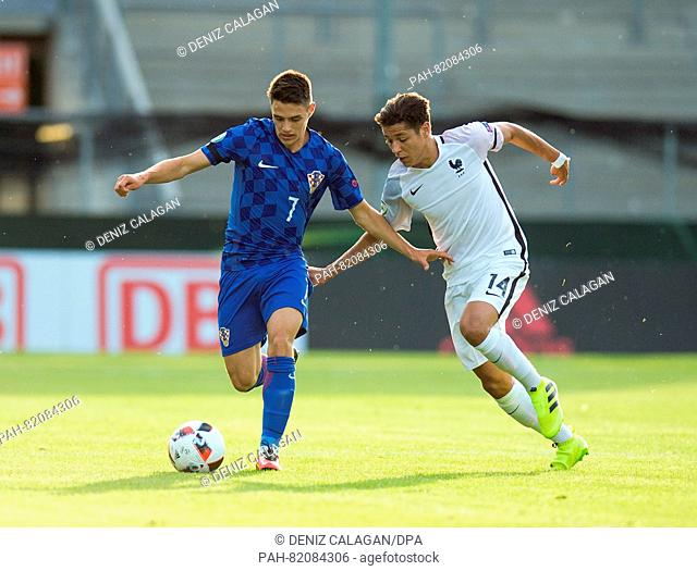 Croatia's Josip Brekalo (l) and France's Amine Harit compete for the ball during the UEFA European Under-19 Championship group B soccer match betweenCroatia and...