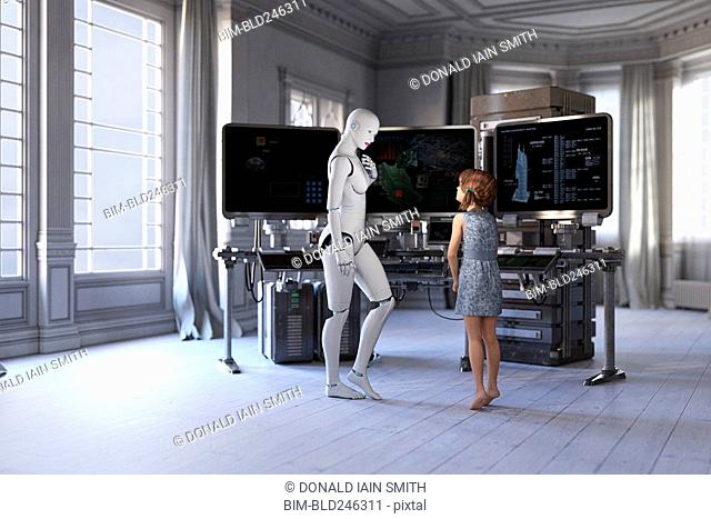 Woman robot and girl standing near computers