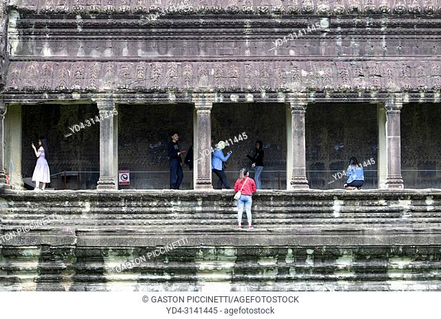 Tourists exploring the Angkor Wat Temple, Angkor Temple Complex, Siem Reap Province, Cambodia, Asia, UNESCO. It was originally constructed as a Hindu temple...