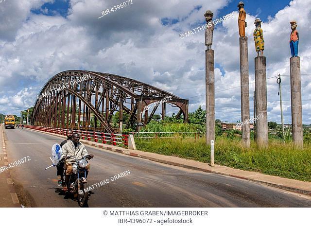 Sanaga River, German Colonial Era railway bridge, two men on a motorbike, Edéa, Littoral Region, Cameroon