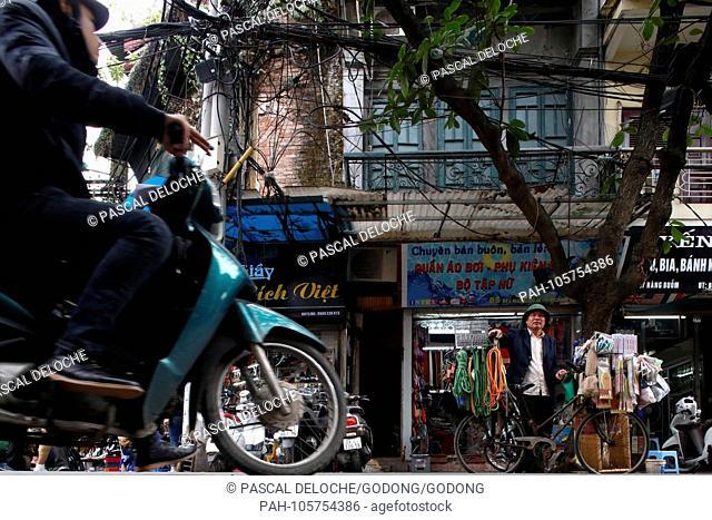 Typical street of the Old Quarter in Hanoi. Chaotic street life traffic. Vietnam. | usage worldwide. - Hanoi/Hanoi/Vietnam