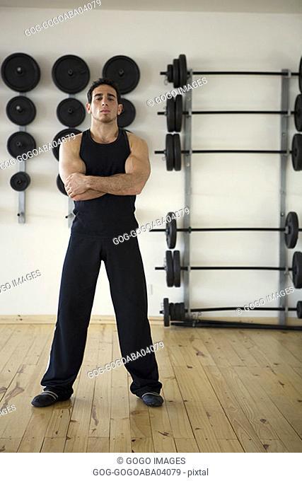 Man standing in weights room