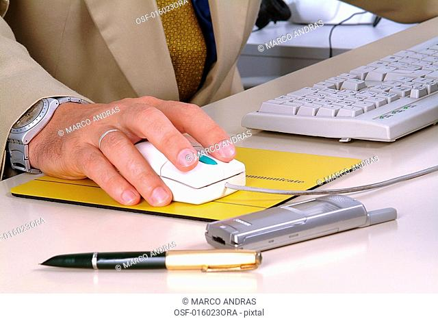 an executive man using the mouse cursor
