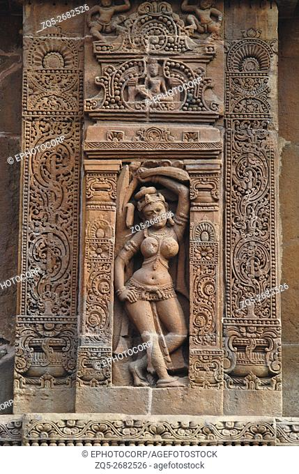 Bhubaneshwar Orissa, Vaital temple, reclining female figure above the lower moldings of the temple. From South-East