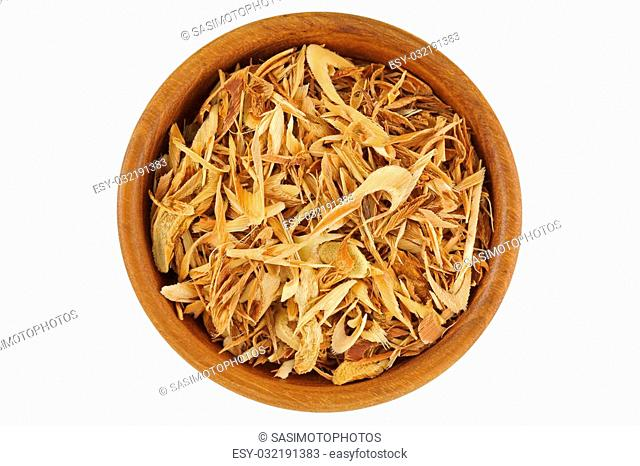 Top view of dried sliced Lemon grass to make tea, in wooden bowl isolated on white background
