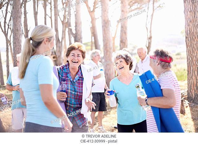 Senior women talking after yoga class in park