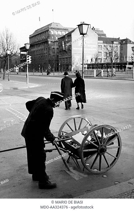 A street cleaner in Berlin. A street cleaner collecting garbage along the Unter den Linden. East Berlin, March 1956