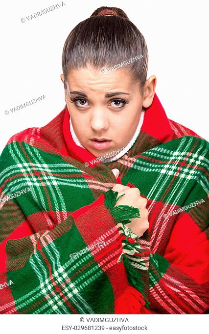 Ill woman is covered with plaid blanket, isolated on the white background