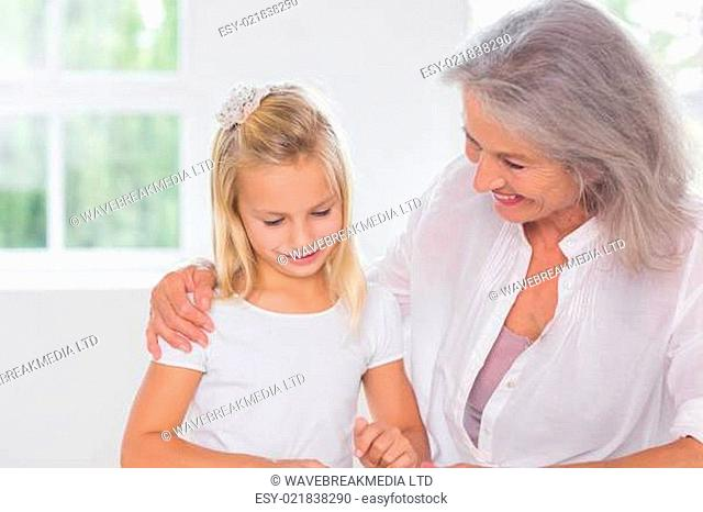 Grandmother talking with her granddaughter