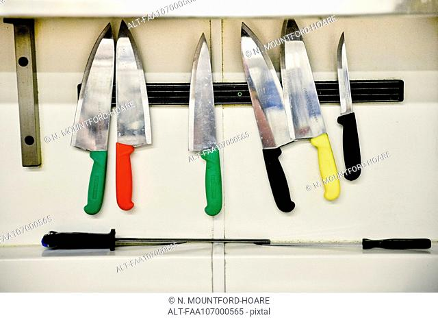 Knives hanging on magnectic strip
