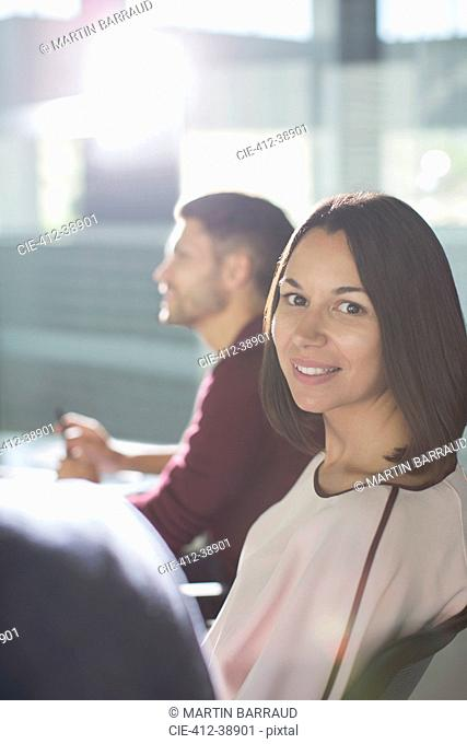 Portrait smiling brunette businesswoman in meeting