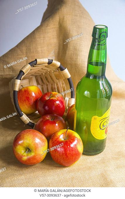 Bottle of cider and apples. Asturias, Spain