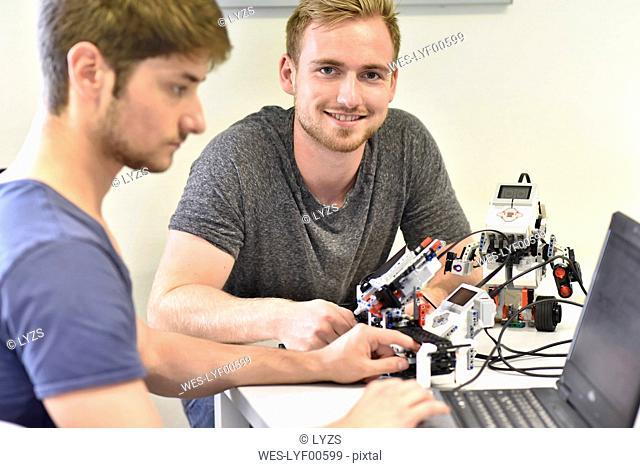 Robotics students with laptop