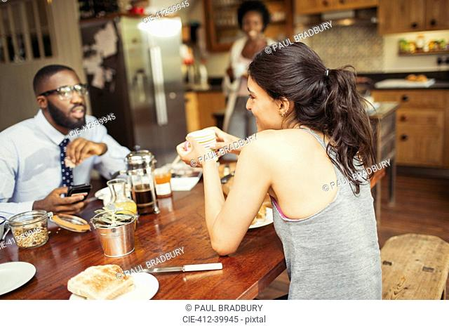 Couple drinking coffee and eating breakfast at table