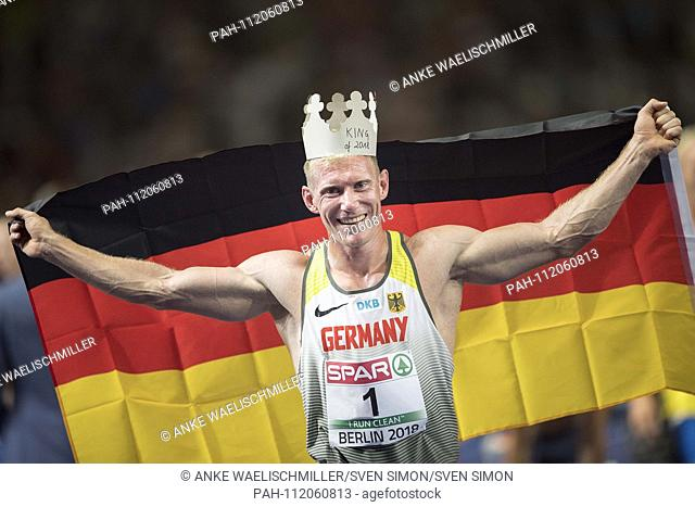 jubilation winner Arthur ABELE (1st place / Germany) with flag and crown. Decathlon 1500m, on 08.08.2018 European Athletics Championships 2018 in Berlin /...