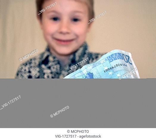 boy with a 20 Euro note - 01/01/2009