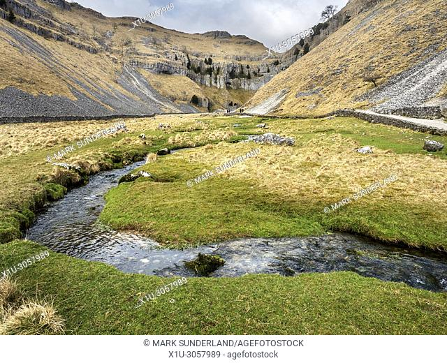 Gordale Beck winding through the valley at Gordale Scar near Malham Yorkshire Dales England