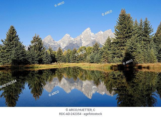 Teton Range mirrored in Snake River Grand Teton national park Wyoming USA Rocky Mountains