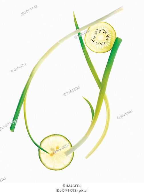 Kiwi and lemon slices and green onion form a frame