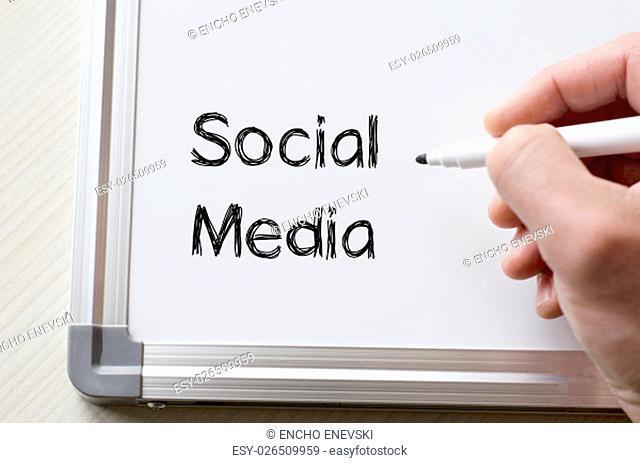 Human hand writing social media on whiteboard