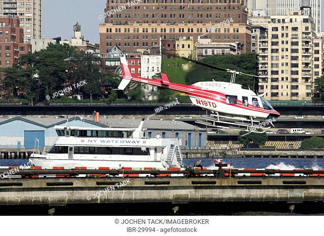 USA, United States of America, New York City: Manhattan Heliport , Downtown at the East River, Skyline of Brooklyn Heights, NY Waterway ferry boat