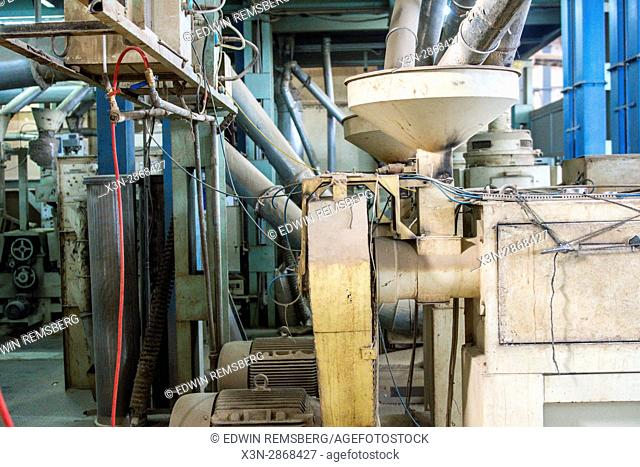 Machinery inside of a rice processing facility in New Delhi, India