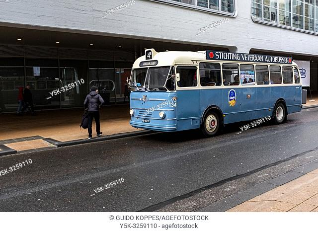 Rotterdam, Netherlands. An Oldtimer Vintage Bus transporting Art Fair Visitors from location to Location