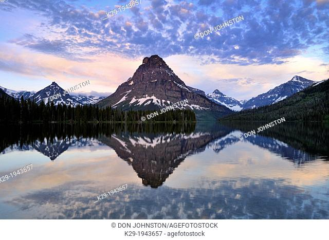 Sinapah Mountain reflected in Two Medicine Lake at dawn, Glacier National Park (Two Medicine sector), Montana, USA