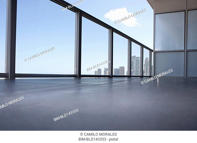 Low angle view of apartment balcony overlooking cityscape
