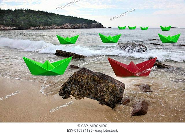 Green paper boats with one red