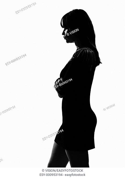 stylish sexy silhouette caucasian beautiful woman sullen sulking on studio isolated white background