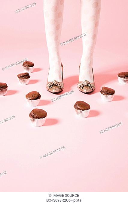 Legs of woman and cakes