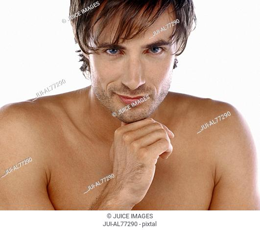Man with bare chest resting head on hand