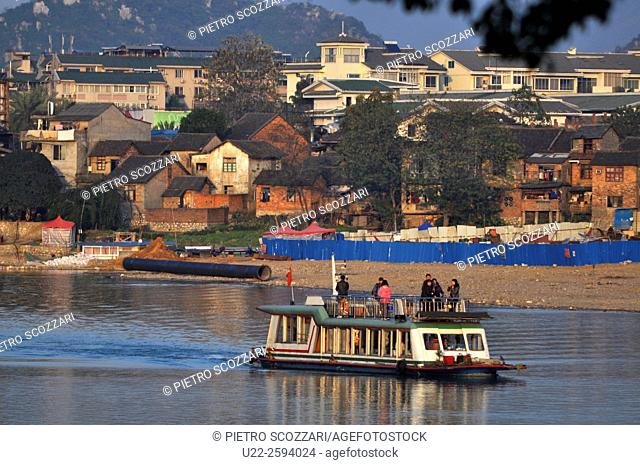 Guilin, China, boat for tourists along the Li River...