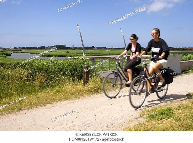 Bikers along the old railway the Groene 62, between Torhout and Ostend, Belgium