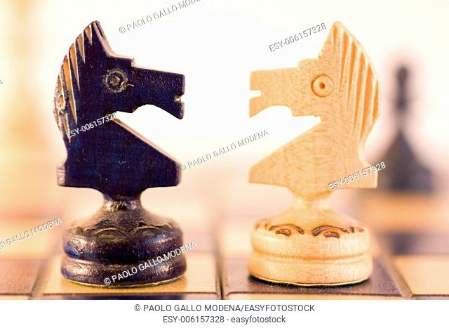 Conceptual with wood chess pieces