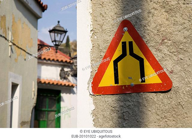 Vathy. Warning sign marking narrowing of street in old town