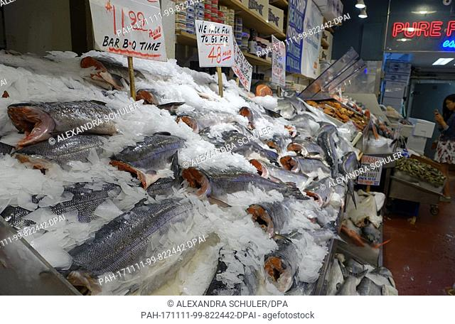 A fish stand sells freshly caught wild salmon at the Pike Place Market in Seattle, United States, 30 August 2017. The Pike Place Market is one of the biggest...