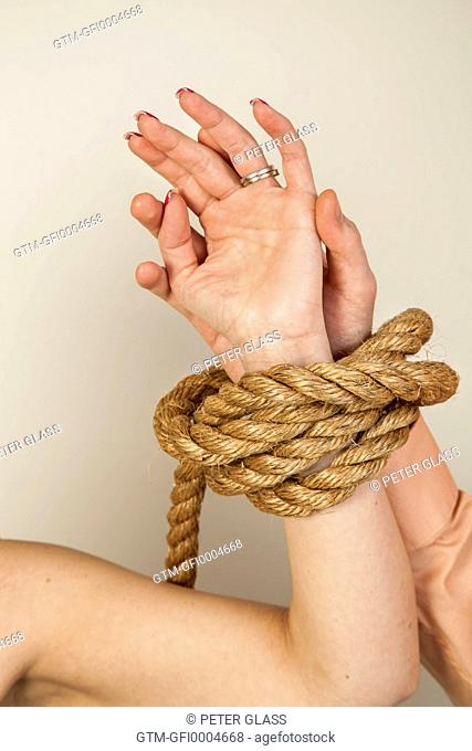 Close-up of a young couple's tied arms