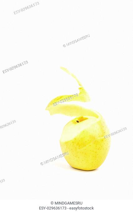 twisted peel of yellow apple on white background
