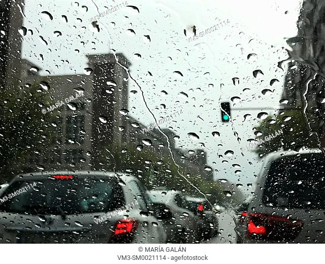 Urban traffic in a rainy day, view from inside a car