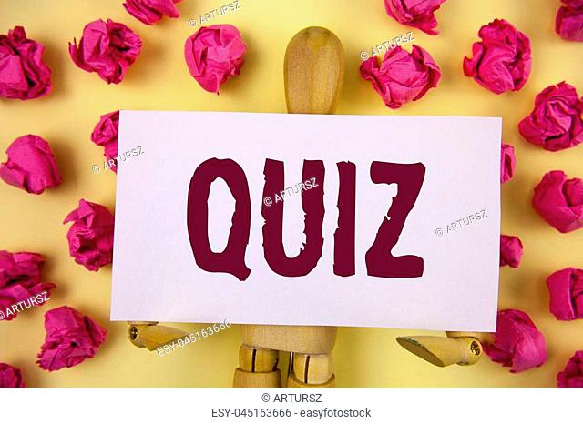 Text sign showing Quiz. Conceptual photo Short Tests Evaluation Examination to quantify your knowledge written Sticky Note paper plain background Paper Balls...