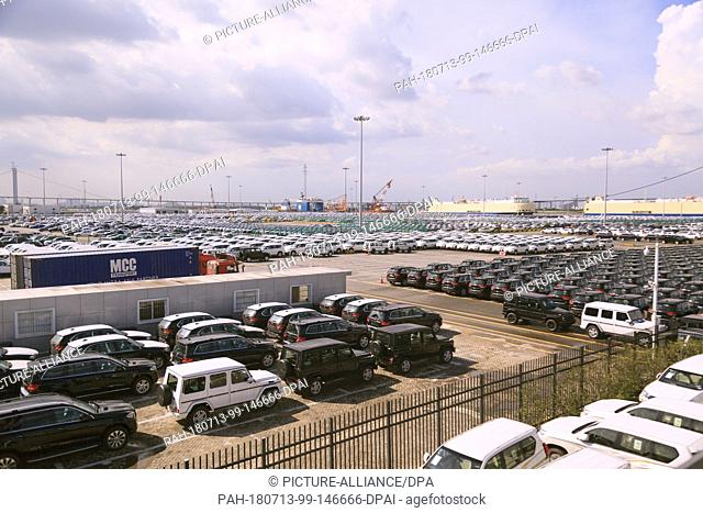 09 July 2018, China, Guangzhou: New cars in a parking lot in the Nansha free trade zone at the port. Photo: Wenjun Chen/dpa. - Guangzhou/China