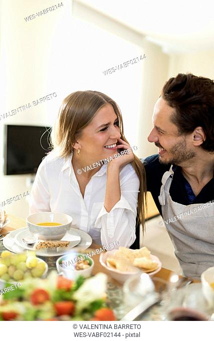 Friends having fun, eating lunch together, couple flirting at the table