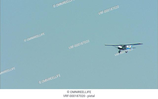 TS WS Light aircraft flying overhead / Howick, KwaZulu-Natal Province, South Africa