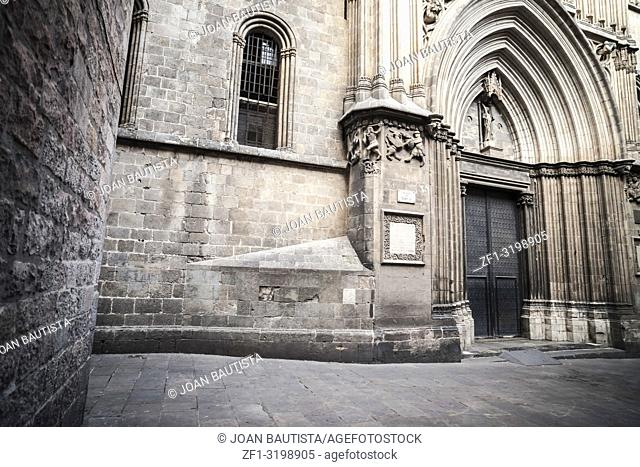 Old street in medieval gothic quarter, door entrance cathedral of Barcelona