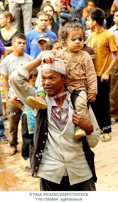 little nepalis girl with her father , the nepalis , life in kathmandu , kathmandu street life , nepal